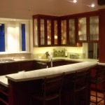 Stone countertops, limestone, fossils, painted cabinets, walnut flooring,contemporary style,