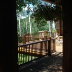 Steel railings, wood decking, lush hanging plants, shady sitting spaces,